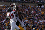 Damontae Kazee #27 of the Atlanta Falcons intercepts a pass intended for Antonio Brown #84 of the Pittsburgh Steelers in the end zone during the first half in the game at Heinz Field on October 7, 2018 in Pittsburgh, Pennsylvania.