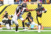 Antonio Brown #84 of the Pittsburgh Steelers makes a catch for a 47 yard touchdown reception in front of Damontae Kazee #27 of the Atlanta Falcons and Robert Alford #23 in the second half during the game at Heinz Field on October 7, 2018 in Pittsburgh, Pennsylvania.