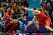 Ersan Ilyasova #7 of the Atlanta Hawks tries to stop Kemba Walker #15 of the Charlotte Hornets during their game at Spectrum Center on January 26, 2018 in Charlotte, North Carolina.  NOTE TO USER: User expressly acknowledges and agrees that, by downloading and or using this photograph, User is consenting to the terms and conditions of the Getty Images License Agreement.