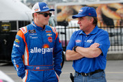 Spencer Gallagher, driver of the #23 Allegiant Chevrolet, talks to Joe Nemechek on the grid during qualifying for the NASCAR Xfinity Series Rinnai 250 at Atlanta Motor Speedway on February 24, 2018 in Hampton, Georgia.