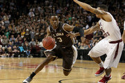 Charlon Kloof #3 of the St. Bonaventure Bonnies handles the ball against Chris Wilson #24 of the Saint Joseph's Hawks in the second half during the Semifinals of the 2014 Atlantic 10 Men's Basketball Tournament  at Barclays Center on March 15, 2014 in the Brooklyn borough of New York City.
