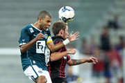 Bady of Atletico-PR competes for the ball with Amaral of Goias during the match between Atletico-PR and Goias for the Brazilian Series A 2014 at Arena da Baixada stadium on November 30, 2014 in Curitiba, Brazil.