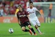 Bady of Atletico-PR competes for the ball with  Gilberto of Internacional during the match between Atletico-PR and Internacional for the Brazilian Series A 2014 at Arena da Baixada stadium on September 20, 2014 in Curitiba, Brazil.