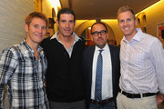 Professional cyclist Cam Wurf (L) and Tour De France cyclist George Hincapie (2nd from L) pose with guests at the 2014 Audi Best Buddies Challenge VIP Reception at Georgetown University on October 17, 2014 in Washington, DC.