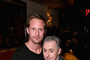 "Alexander Skarsgard and Alan Cumming attend a special performance of ""Legal Immigrant"" at Audible's Minetta Lane Theatre on April 12, 2019 in New York City."
