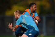 Kurtley Beale of Australia is tackled by Billy Meakes of Australia during a training session at the Lensbury Hotel on November 16, 2017 in London, England.