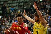 Liu Wei of China drives to the basket against Matthew Dellavedova of the Boomers during game three of the international series between the Australian Boomers and China at Challenge Stadium on June 13, 2012 in Perth, Australia.