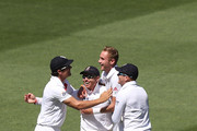 Alastair Cook (L) Stuart Broad (C) and Jonny Bairstow (R) of England hug Ian Bell who caught out Steve Smith of Australia during day two of the Fourth Ashes Test Match between Australia and England at Melbourne Cricket Ground on December 27, 2013 in Melbourne, Australia.