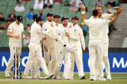 Jonny Bairstow and Stuart Broad of England celebrate after dismissing Shaun Marsh of Australia during day one of the Fourth Test Match in the 2017/18 Ashes series between Australia and England at Melbourne Cricket Ground on December 30, 2017 in Melbourne, Australia.