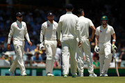 Steve Smith of Australia looks on as Joe Root of England discusses a review with Jonny Bairstow  and James Anderson during day three of the Third Test match during the 2017/18 Ashes Series between Australia and England at WACA on December 16, 2017 in Perth, Australia.