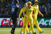 Grant Elliott of New Zealand and Brad Haddin of Australia exchange words aftera review off Glenn Maxwell's bowling during the 2015 ICC Cricket World Cup final match between Australia and New Zealand at Melbourne Cricket Ground on March 29, 2015 in Melbourne, Australia.