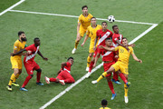 Anderson Santamaria, Pedro Aquino of Peru, and Trent Sainsbury of Australia compete for a header during the 2018 FIFA World Cup Russia group C match between Australia and Peru at Fisht Stadium on June 26, 2018 in Sochi, Russia.