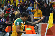 Tim Cahill of Australia celebrates scoring the opening goal during the 2010 FIFA World Cup South Africa Group D match between Australia and Serbia at Mbombela Stadium on June 23, 2010 in Nelspruit, South Africa.