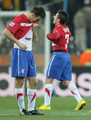 Aleksandar Lukovic of Serbia and Zoran Tosic of Serbia are dejected at the final whistle after being knocked out of the competition during the 2010 FIFA World Cup South Africa Group D match between Australia and Serbia at Mbombela Stadium on June 23, 2010 in Nelspruit, South Africa.