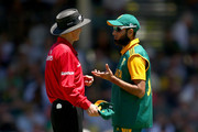 Umpire Billy Bowden talks with Imran Tahir of South Africa during the One Day International match between Australia and South Africa at the WACA on November 16, 2014 in Perth, Australia.
