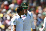 Imran Tahir of South Africa is given encouragement from his captain Graeme Smith of South Africa during day one of the 2nd Test match between Australia and South Africa at Adelaide Oval on November 22, 2012 in Adelaide, Australia.