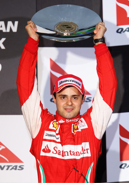 Felipe Massa of Brazil and Ferrari celebrates finishing third during the Australian Formula One Grand Prix at the Albert Park Circuit on March 28, 2010 in Melbourne, Australia.