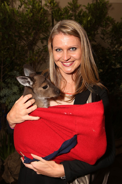 Lucie Safarova poses with a joey as she arrives at the official Australian Open player party at the Grand Hyatt on January 11, 2013 in Melbourne, Australia.