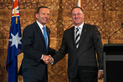 Australian Prime Minister Tony Abbott, left, shakes hands with New Zealand Prime Minister John Key after a joint media conference at Government House on February 28, 2015 in Auckland, New Zealand. Prime Minister Abbott is on his first official two day visit to New Zealand.