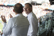 New Zealand Prime Minister John Key (R) and Australian Prime Minister Tony Abbott at Eden Park watch New Zealand - Australia Cricket World Cup Pool A match on February 28, 2015 in Auckland, New Zealand. Toda marks Abbott's first official visit to New Zealand as Prime Minister.