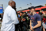 DJ Skee (right) and television personality Ephraim Salaam (left) speak on pit road prior to the NASCAR Sprint Cup Series Auto Club 400 at Auto Club Speedway on March 23, 2014 in Fontana, California.