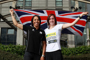 Dame Kelly Holmes poses with her protege Laura Weightman in a photocall at the Aviva sponsored 'On Camp with Kelly Media Day' press conference during the Aviva London Grand Prix on July 14, 2012 in Croydon, England.