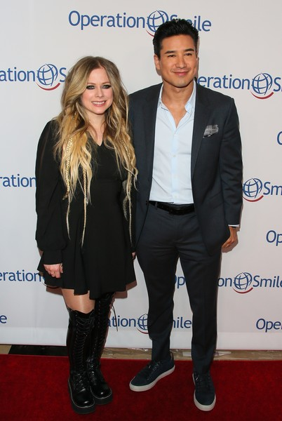 Operation Smile's Hollywood Fight Night Hosted By Brooke Burke And Manny Pacquiao [suit,carpet,event,fashion,footwear,premiere,outerwear,long hair,formal wear,style,brooke burke,manny pacquiao,avril lavigne,mario lopez,california,los angeles,beverly hilton,operation smile,hollywood fight night]