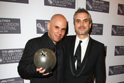 Yaron Shani (L) poses with the Sutherland award for the film AJAMI and Alfonso Cuaron during the Times BFI 53rd London Film Festival Awards Ceremony at Inner Temple on October 28, 2009 in London, England.