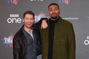 """Matthew Morrison (L) and Jordan Banjo attend a photocall for the BBC's """"The Greatest Dancer"""" at The May Fair Hotel on December 10, 2018 in London, England."""