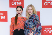 """Lily Collins and Ellie Bamber attend a photocall for BBC One's """"Les Miserables"""" at BAFTA on December 05, 2018 in London, England."""