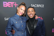"""Paula Patton and Marques Houston attend BET+ and Footage Film's """"Sacrifice"""" premiere event at Landmark Theatre on December 11, 2019 in Los Angeles, California."""