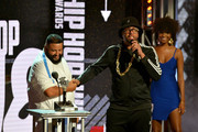 Host Deray Davis (R) interrupts DJ Khaled (L) onstage during the BET Hip Hop Awards 2018 at Fillmore Miami Beach on October 6, 2018 in Miami Beach, Florida.