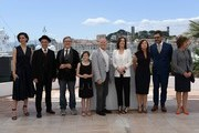 """(FromL) British actress Rebecca Hall, British actor Mark Rylance, US director Steven Spielberg, US actress Ruby Barnhill, US producer Frank Marshall, US producer Kathleen Kennedy, US producer Kristie Macosko, New Zealander actor Jemaine Clement and British actress Penelope Wilton pose on May 14, 2016 during a photocall for the film """"The BFG"""" at the 69th Cannes Film Festival in Cannes, southern France.  / AFP / ANNE-CHRISTINE POUJOULAT"""