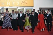 """(FromL) British actress Rebecca Hall, British actress Penelope Wilton, US director Steven Spielberg, US actress Ruby Barnhill, British actor Mark Rylance, US producer Kathleen Kennedy and US producer Frank Marshall leave the Festival Palace on May 14, 2016 after the screening of the film """"The BFG"""" at the 69th Cannes Film Festival in Cannes, southern France.  / AFP / ALBERTO PIZZOLI"""