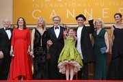 """(FromL) US producer Frank Marshall, US producer Kathleen Kennedy, US director Steven Spielberg and his wife Kate Capshaw, US actress Ruby Barnhill, British actor Mark Rylance and his wife British director Claire van Kampen and author Lucy Dahl pose on May 14, 2016 as they arrive for the screening of the film """"The BFG"""" at the 69th Cannes Film Festival in Cannes, southern France.. / AFP / Valery HACHE"""