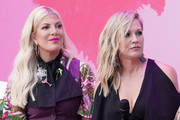 (L-R) Tori Spelling and Jennie Garth participate in the Beverly Hills 90210 Costume Exhibit Event at The Atrium at Westfield Century City on August 19, 2019 in Los Angeles, California.
