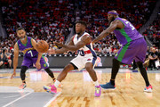 Nate Robinson #11 of Tri-State passes the ball between Mahmoud Abdul-Rauf #7 and Reggie Evans #30 of the 3 Headed Monsters during BIG3 - Week Four at Little Caesars Arena on July 13, 2018 in Detroit, Michigan.