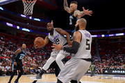 Mario West #19 of the Ghost Ballers passes the ball to Carlos Boozer #5 while being guarded by Chris Andersen #11 of Power during BIG3 - Week Four at Little Caesars Arena on July 13, 2018 in Detroit, Michigan.