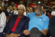 Head coach Julius Erving of the Tri-State (L) sits next to Bill Russell while attending week nine of the BIG3 three-on-three basketball league at KeyArena on August 20, 2017 in Seattle, Washington.