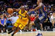 Chauncey Billups #1 of the Killer 3s drives past Andre Owens #20 of 3's Company during week seven of the BIG3 three on three basketball league at Rupp Arena on August 6, 2017 in Lexington, Kentucky.