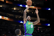 Larry Sanders #8 of the 3 Headed Monsters shoots a basket over Donte Greene #20 of Killer 3s during week three of the BIG3 three on three basketball league at State Farm Arena on July 07, 2019 in Atlanta, Georgia.