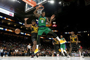 Larry Sanders #8 of the 3 Headed Monsters and Donte Greene #20 of Killer 3s collide mid-air during week three of the BIG3 three on three basketball league at State Farm Arena on July 07, 2019 in Atlanta, Georgia.