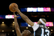 Jerome Williams #13 of Power defends against Chauncey Billups #1 of Killer 3s during week two of the BIG3 three on three basketball league at Spectrum Center on July 2, 2017 in Charlotte, North Carolina.