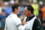 Justin Rose of England celebrates with his caddie Mark Fulcher after finishing -13 following the final round to win the BMW Championship at Cog Hill Golf & Country Club on September 18, 2011 in Lemont, Illinois.
