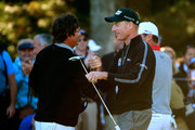 Jim Furyk (R) shakes hands with Jason Dufner after putting on the ninth green to shoot a 59 during the Second Round of the BMW Championship at Conway Farms Golf Club on September 13, 2013 in Lake Forest, Illinois.