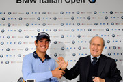 Matteo Manassero (L) of Italy shakes hands with Franco Chimenti, president of the Italian golf federation during a press conference prior to starting his professional career at the BMW Italian Open at Royal Park I Roveri on May 5, 2010 in Turin, Italy.