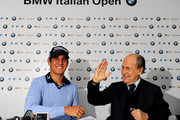 Matteo Manassero of Italy shakes hands with Franco Chimenti, president of the Italian golf federation during a press conference prior to starting his professional career at the BMW Italian Open at Royal Park I Roveri on May 5, 2010 in Turin, Italy.