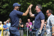 Footballers Jamie Redknapp and Robbie Fowler celebrate during the Pro Am for the BMW PGA Championship at Wentworth on May 23, 2018 in Virginia Water, England.