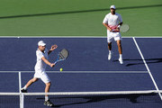 Andy Roddick and James Blake of USA volley during their match against Andy Murray and Ross Hutchins of Great Britain during the BNP Paribas Open at the Indian Wells Tennis Garden on March 13, 2010 in Indian Wells, California.