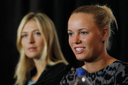 (L-R)  Caroline Wozniacki speaks to the media as Maria Sharapova looks on during a press conference for the BNP Paribas Showdown on March 5, 2012 at the Essex House in New York City.